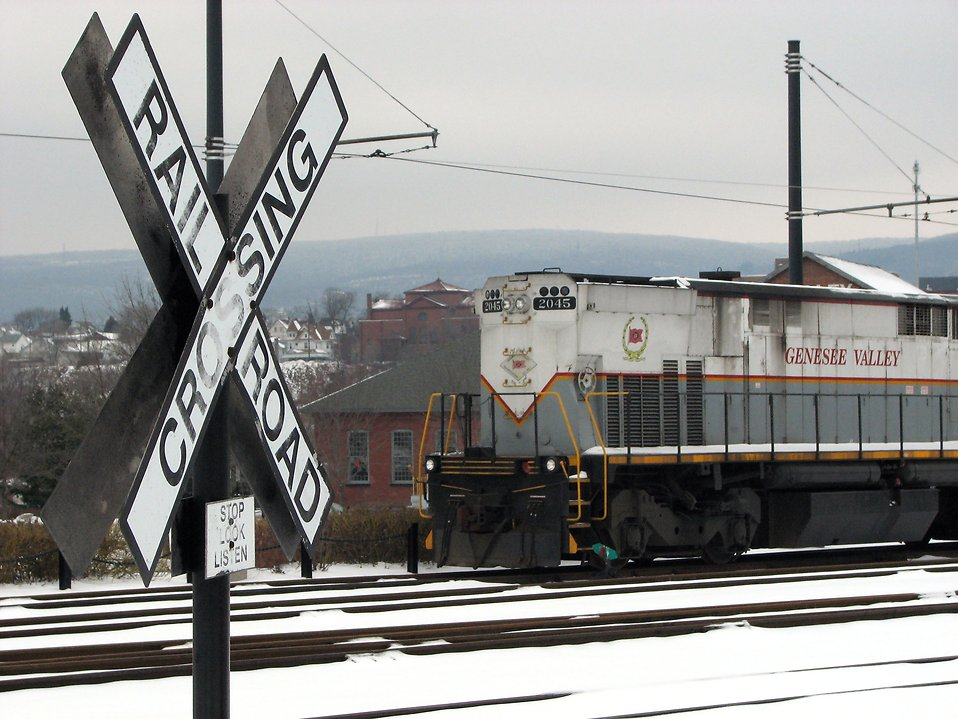 A train passing by a railroad crossing sign : Free Stock Photo