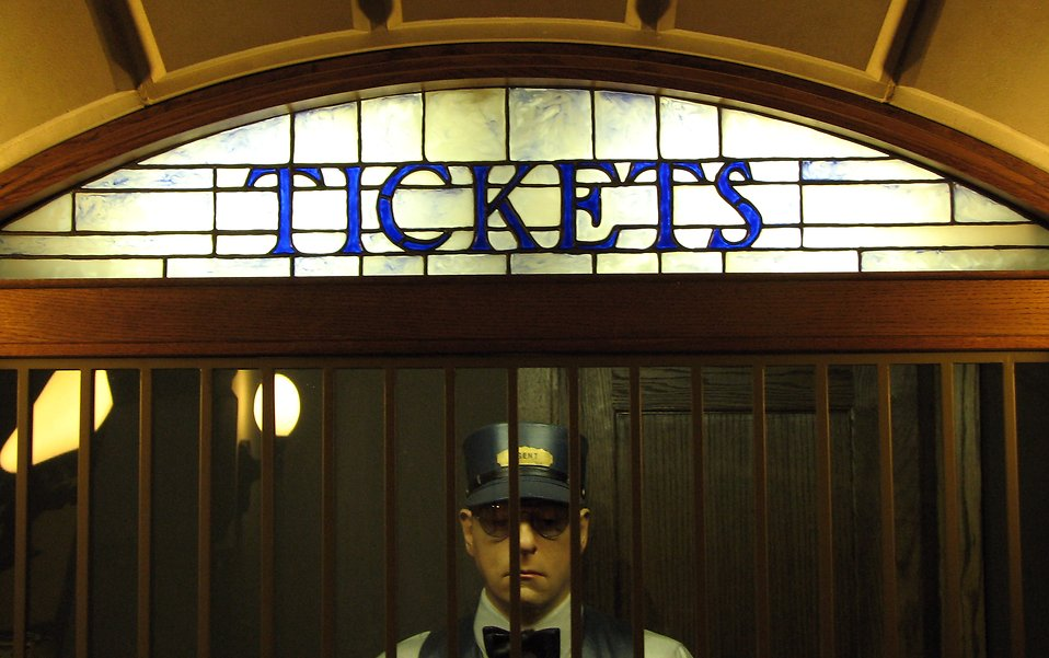 Statue of a man in a ticket booth : Free Stock Photo