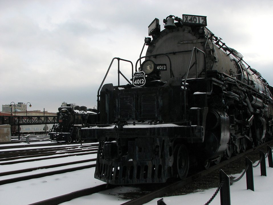 Front view of a steam locomotive in the snow : Free Stock Photo