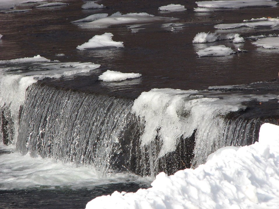 Snow and ice around a small waterfall in a stream : Free Stock Photo