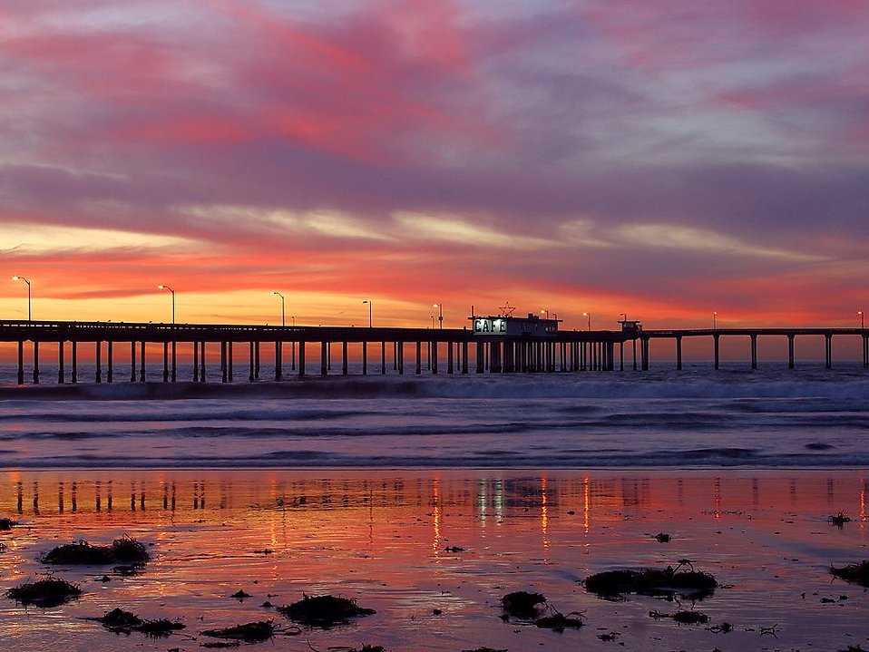 A pier over the ocean at sunset : Free Stock Photo
