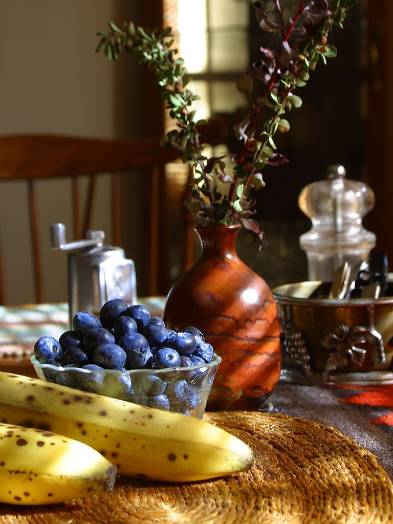 Bananas and blueberries on a table : Free Stock Photo