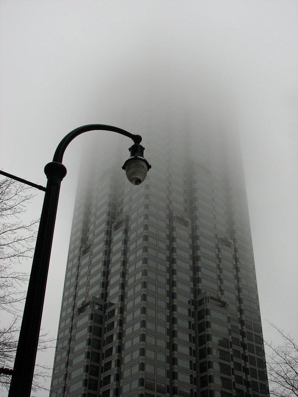 A skyscraper covered in fog : Free Stock Photo
