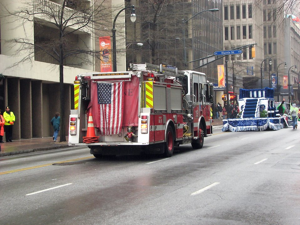 A firetruck with an American flag in the 2009 Atlanta Saint Patricks Day Parade : Free Stock Photo