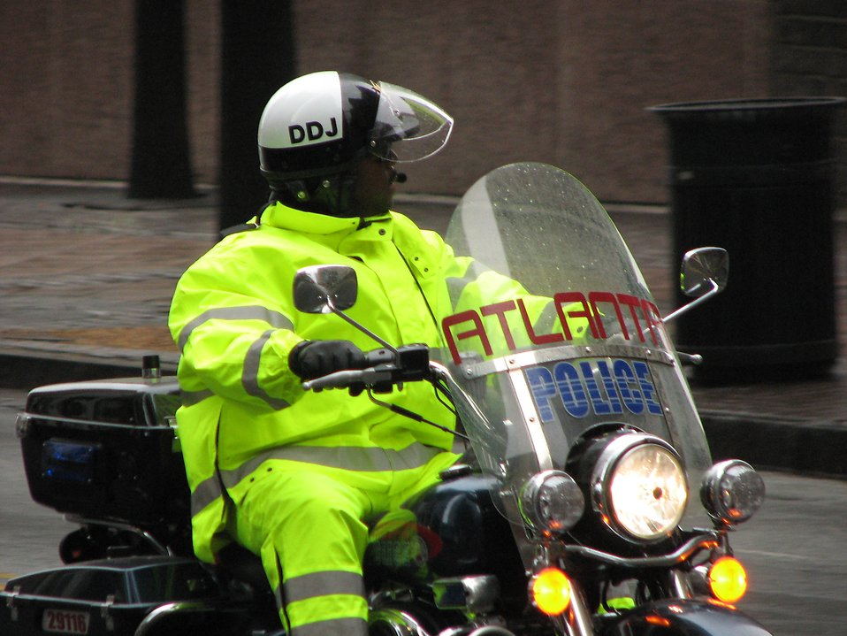 An Atlanta police officer on a motorcycle in the 2009 Atlanta Saint Patricks Day Parade : Free Stock Photo
