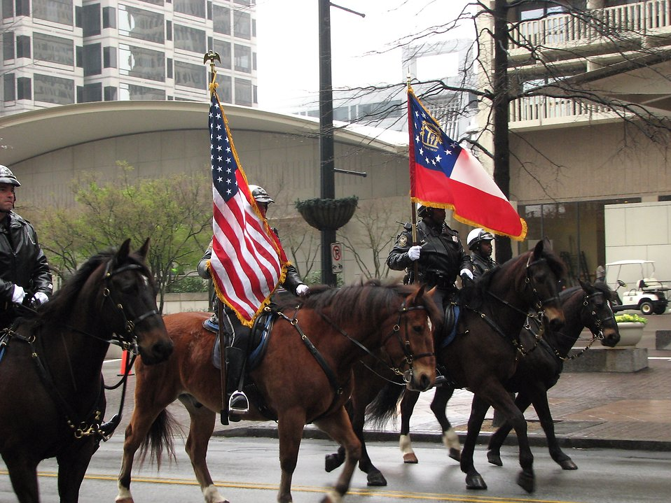 Mounted police officers with flags at the 2009 Atlanta Saint Patricks Day Parade : Free Stock Photo