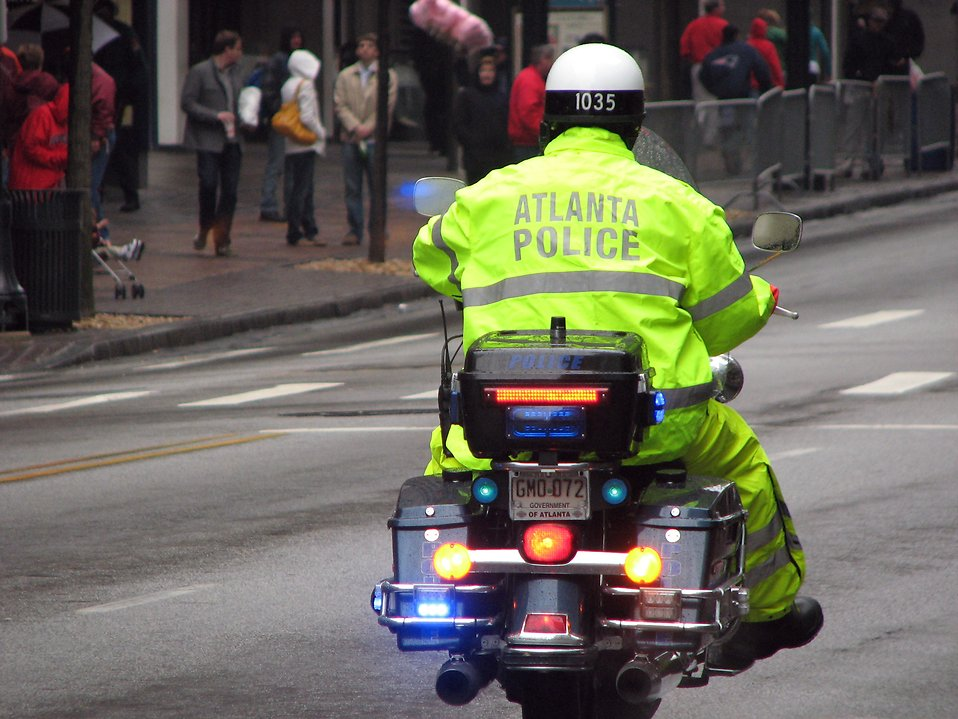 An Atlanta police officer on a motorcycle at the 2009 Atlanta Saint Patricks Day Parade : Free Stock Photo