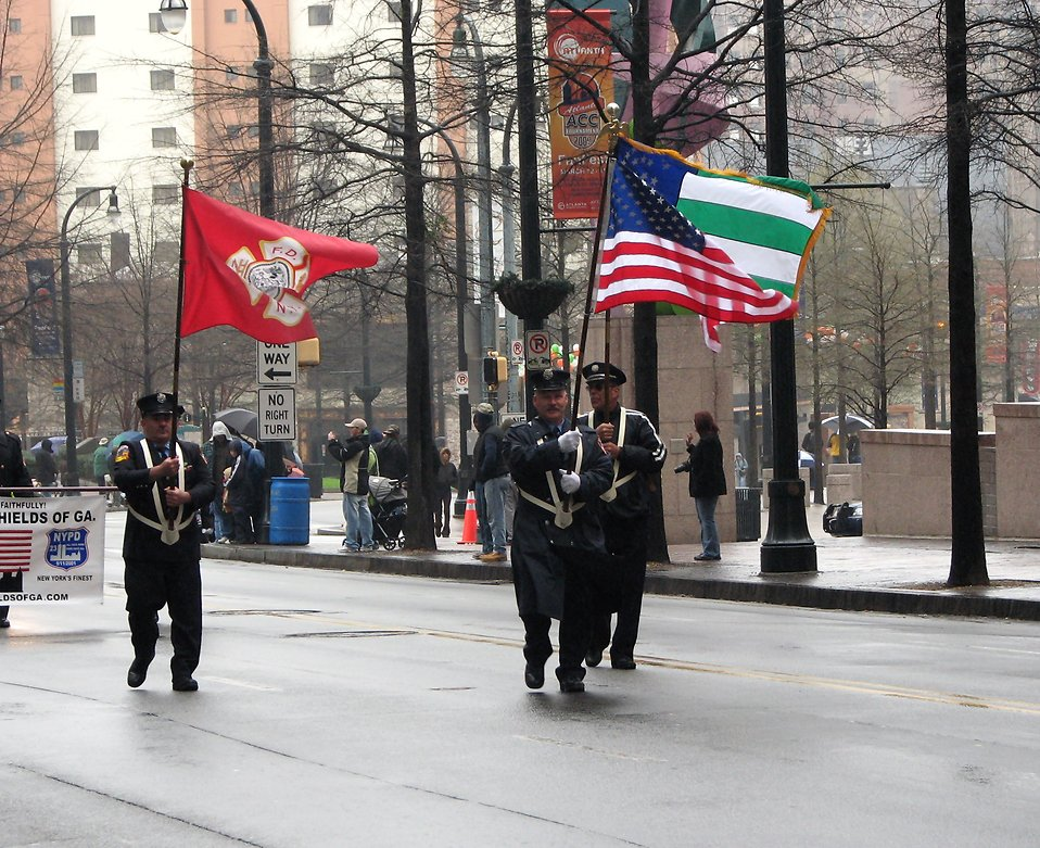 Police officers marching with flags in the 2009 Atlanta Saint Patricks Day Parade : Free Stock Photo
