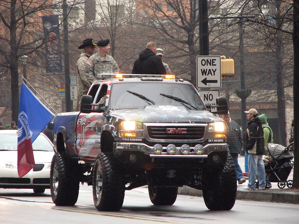 A patriotic painted truck with soldiers in the 2009 Atlanta Saint Patricks Day Parade : Free Stock Photo