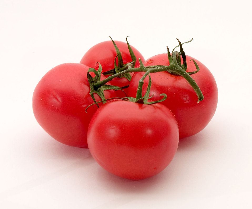 Red tomatoes isolated on a white background.