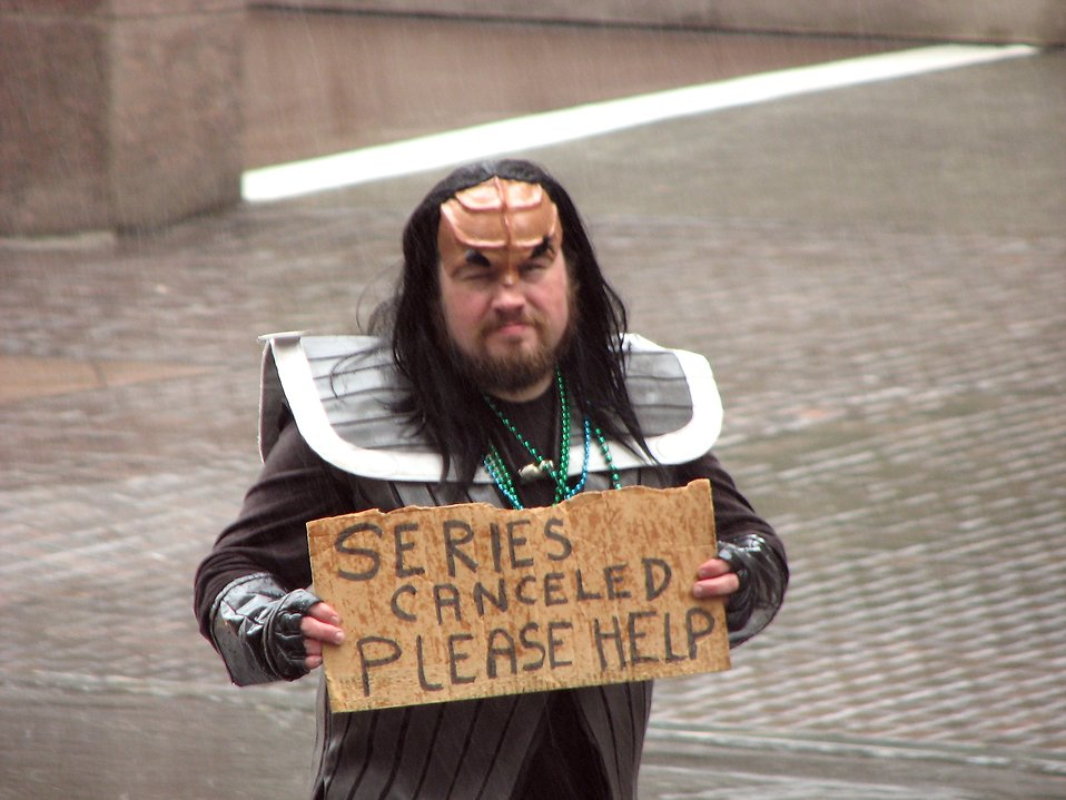 A man in a Klingon costume with sign in the rain in the 2009 Atlanta Saint Patricks Day Parade : Free Stock Photo