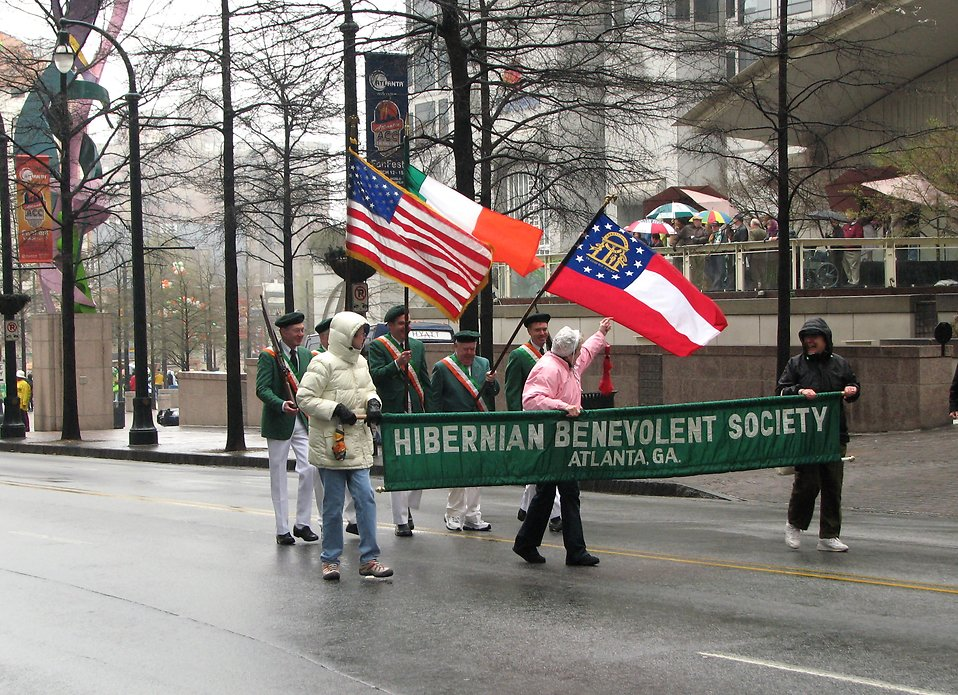 People marching with flags in the 2009 Atlanta Saint Patricks Day Parade.