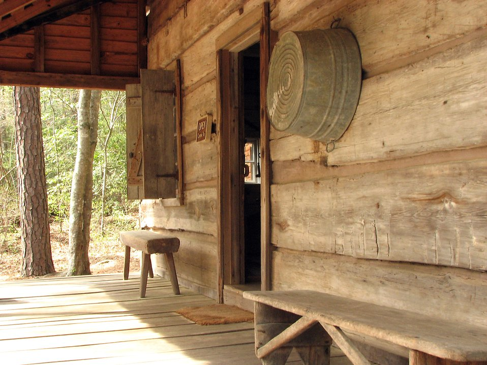 Front entrance to an old wooden log cabin : Free Stock Photo