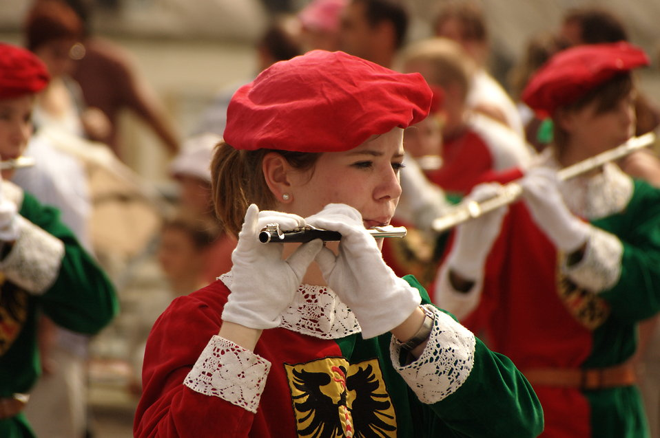 Closeup of a girl playing the flute in a parade : Free Stock Photo