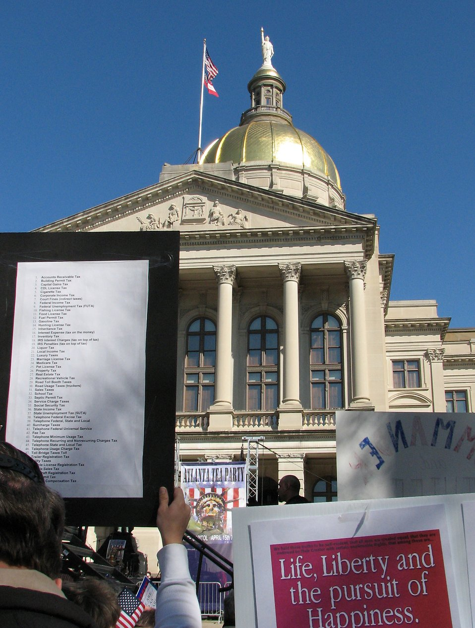 Protesters with signs in front of the State Capitol building at the 2009 tax day tea party in Atlanta, Georgia : Free Stock Photo