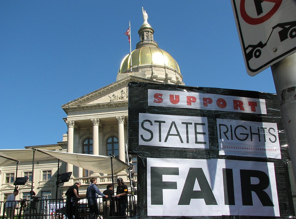 A protest sign in front of the State Capitol building at the 2009 tax day tea party in Atlanta, Georgia : Free Stock Photo