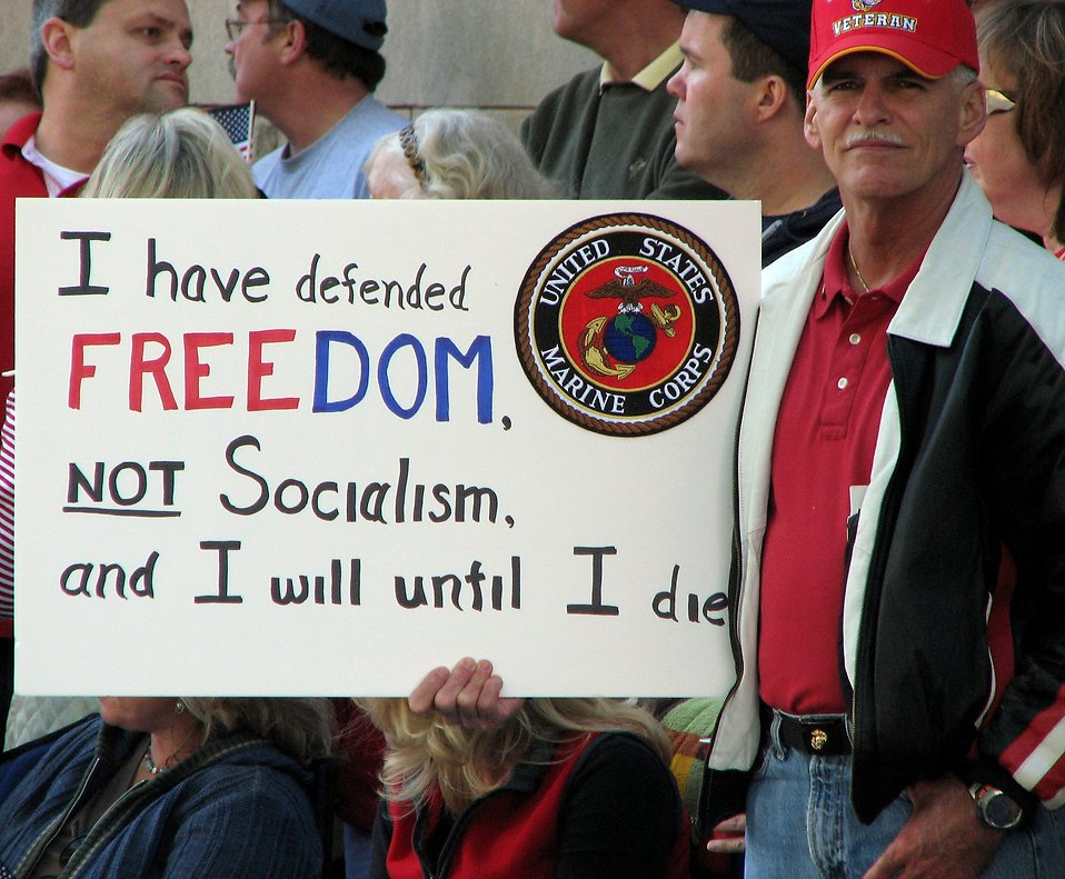 A war veteran with a sign at the 2009 tax day tea party in Atlanta, Georgia : Free Stock Photo