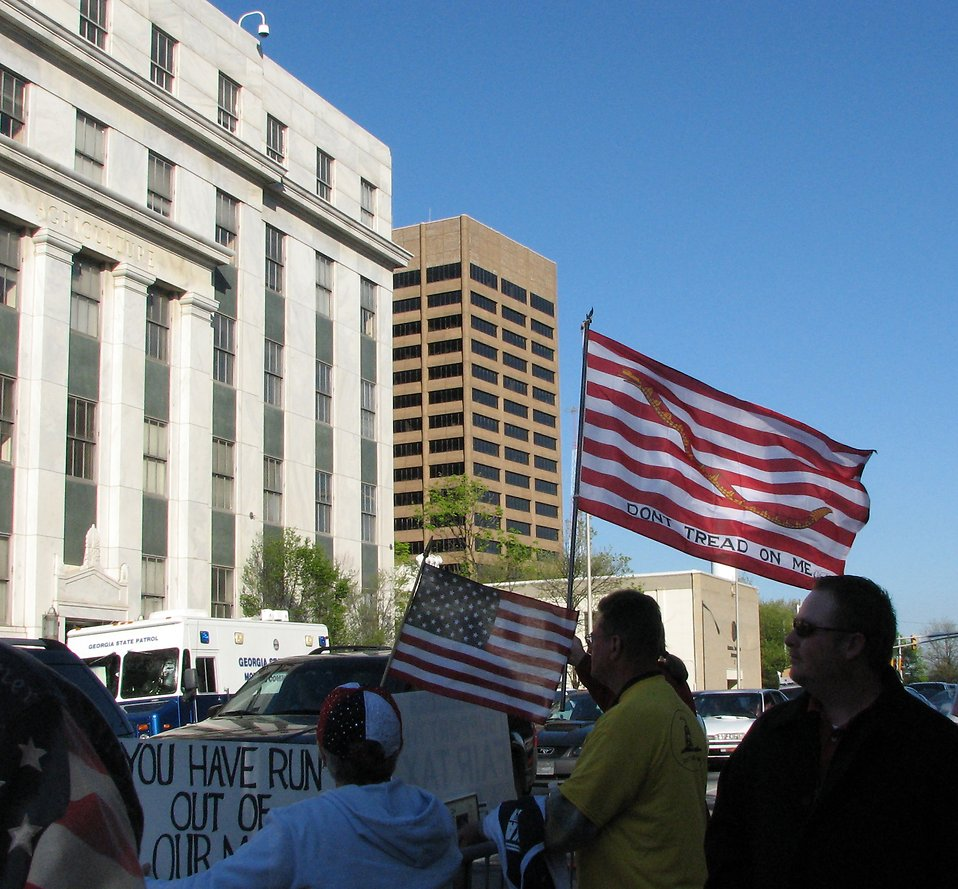 Protesters with signs and flags at the 2009 tax day tea party in Atlanta, Georgia : Free Stock Photo