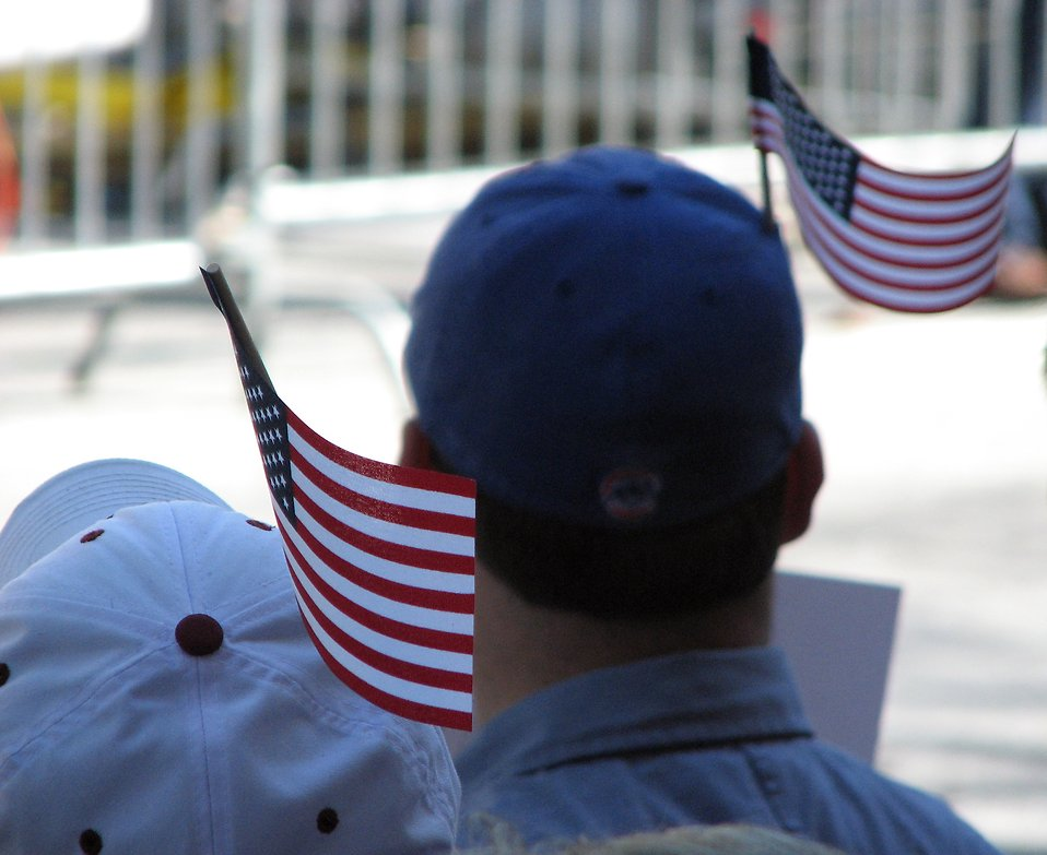 Protesters with flags in their hats at the 2009 tax day tea party in Atlanta, Georgia : Free Stock Photo