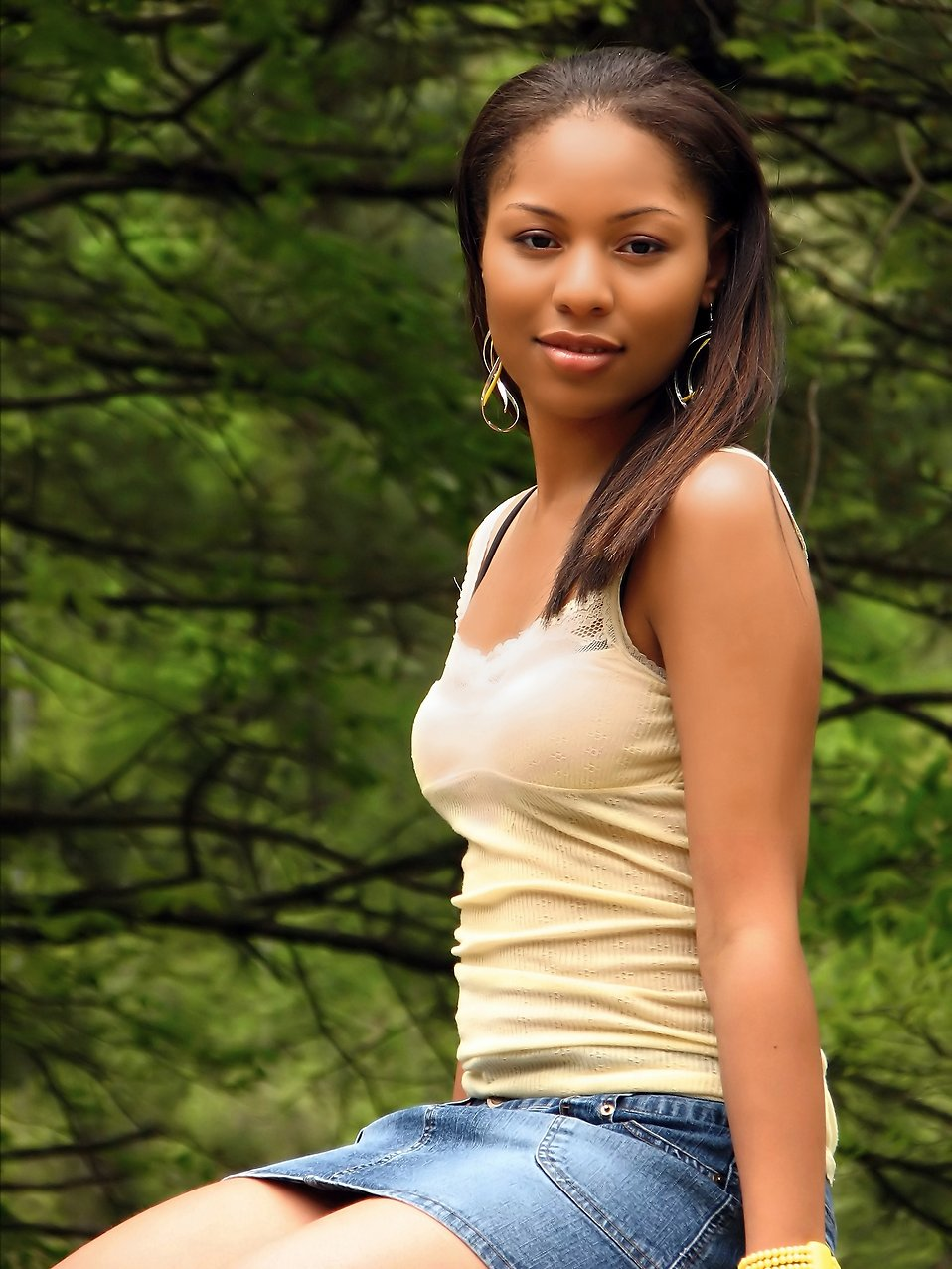 A beautiful African American teen girl posing in the woods : Free Stock Photo