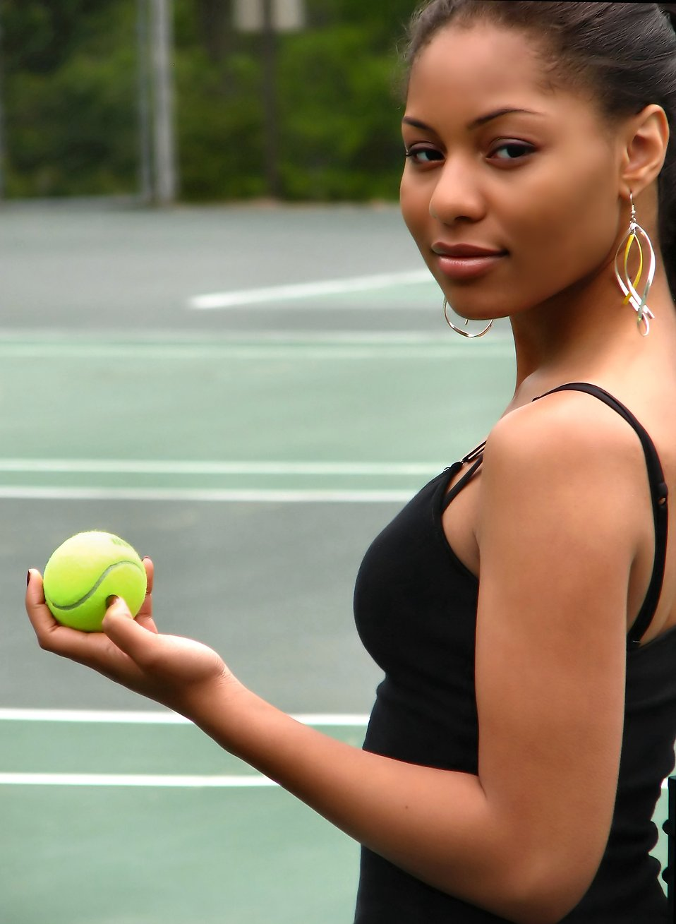A beautiful African American teen girl holding a tennis ball : Free Stock Photo