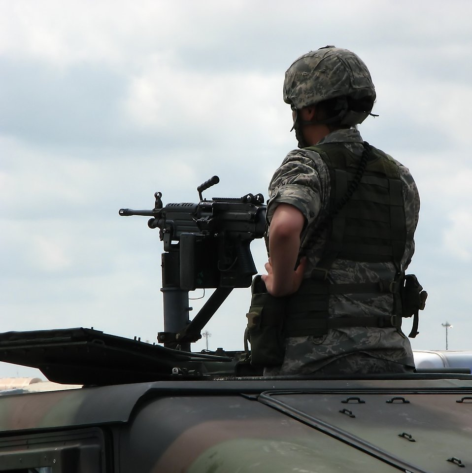 A female soldier on top of a humvee with a gun at the 2009 Robins AFB Air Show in Warner Robins, Georgia.