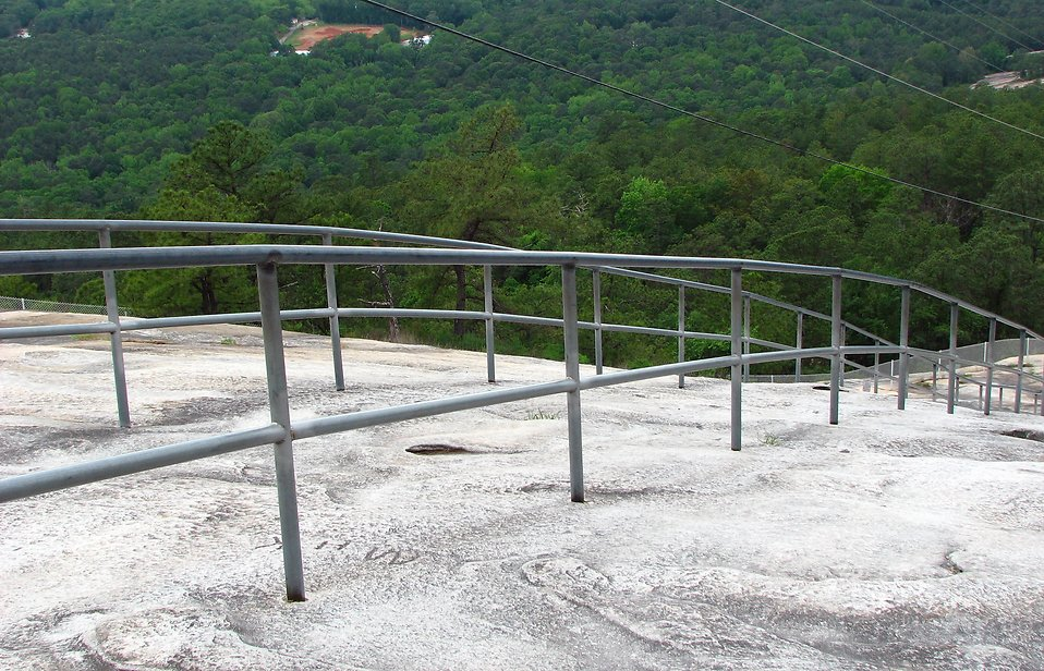 A railing on the side of Stone Mountain in Georgia : Free Stock Photo