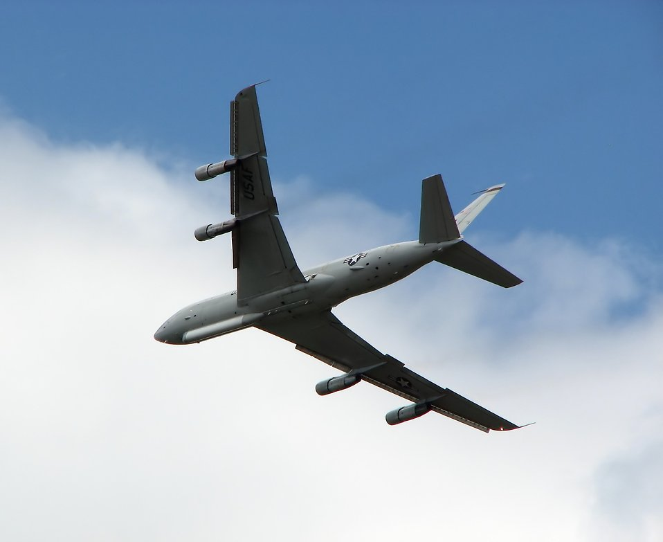 A large military plane flying in the sky at the 2009 Robins AFB Air Show : Free Stock Photo