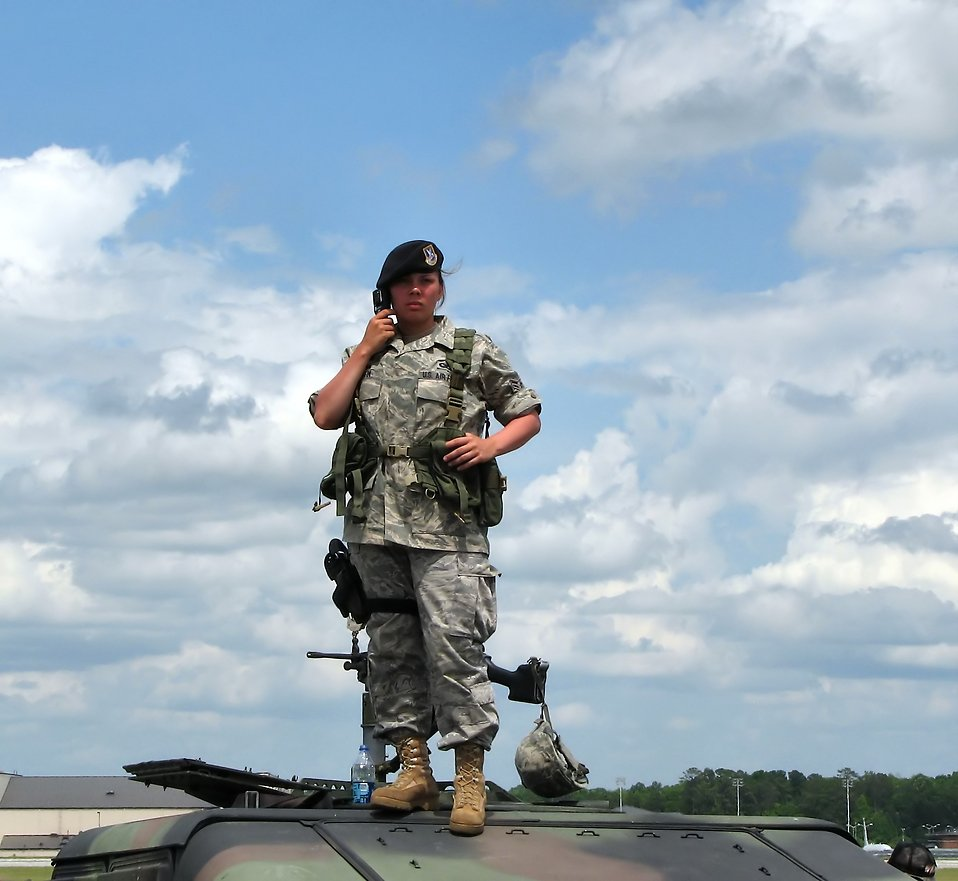 A female soldier on top of a humvee at the 2009 Robins AFB Air Show. : Free Stock Photo