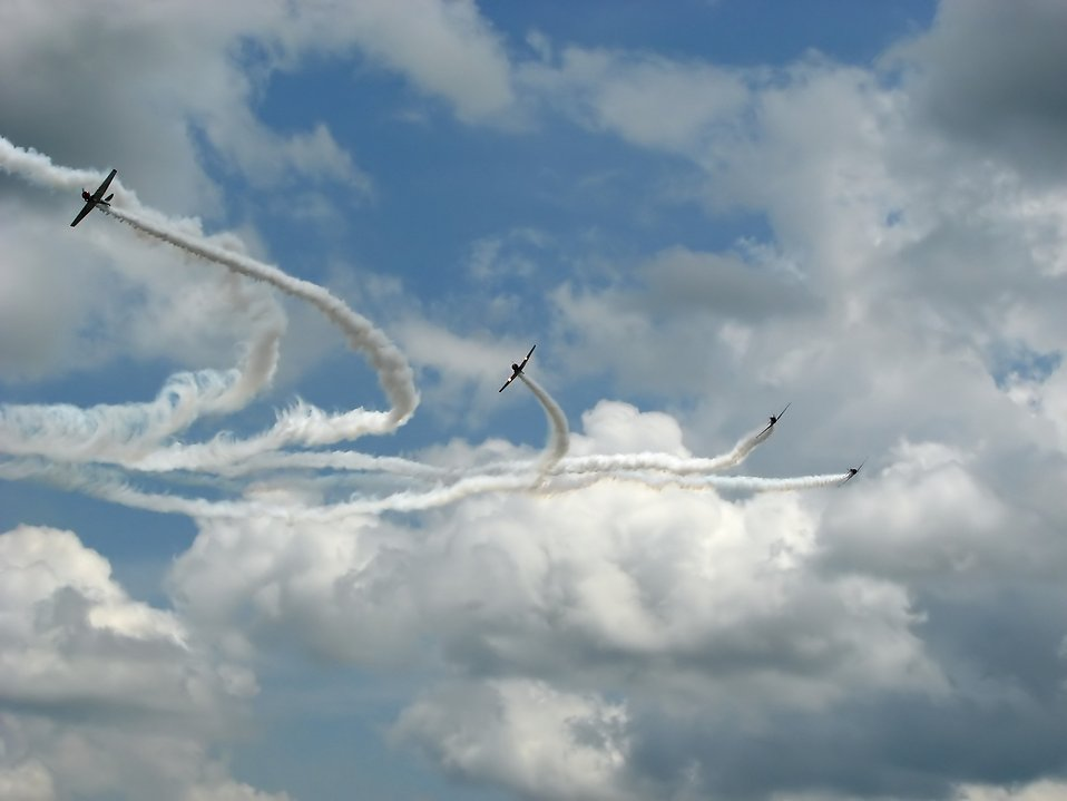Vintage SNJ-2 WW2 fighter planes flying in formation with smoke trails : Free Stock Photo