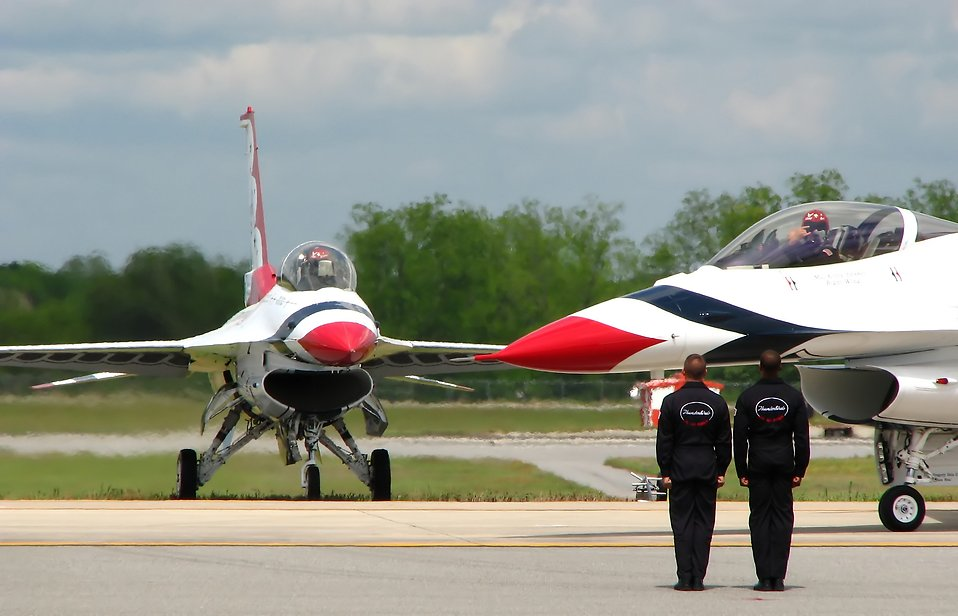 F-16 Air Force Thunderbird jets with crew members on a runway at the 2009 Robins AFB Air Show. : Free Stock Photo