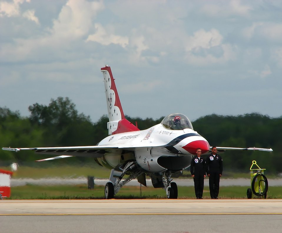 An F-16 Air Force Thunderbird jet with crew members on a runway at the 2009 Robins AFB Air Show. : Free Stock Photo