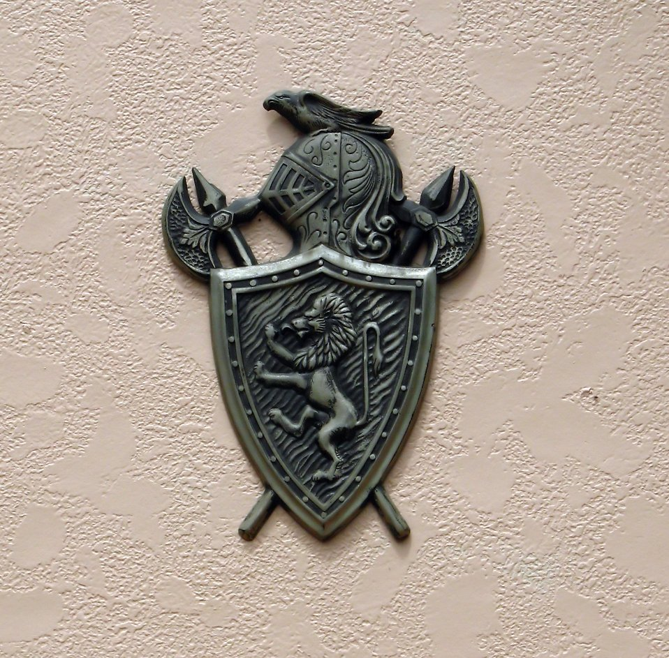 A medieval coat of arms on a wall : Free Stock Photo