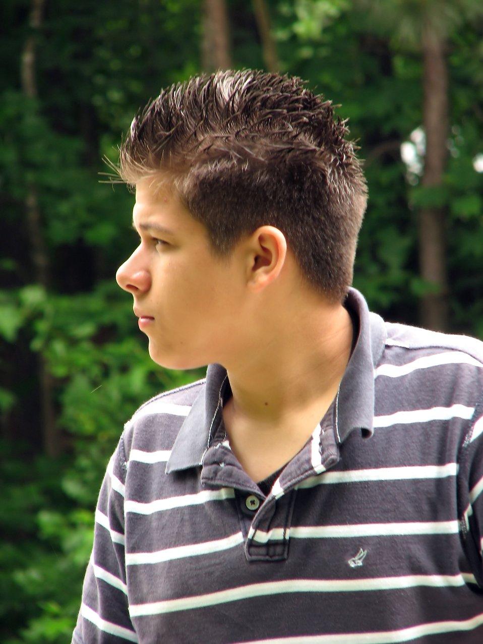 A young latino man posing outdoors : Free Stock Photo