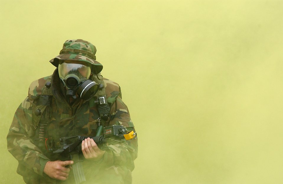 Soldier in gas mask with cloud of smoke : Free Stock Photo