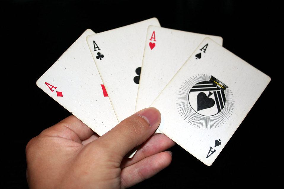 A hand holding the four Aces in a standard deck of cards : Free Stock Photo