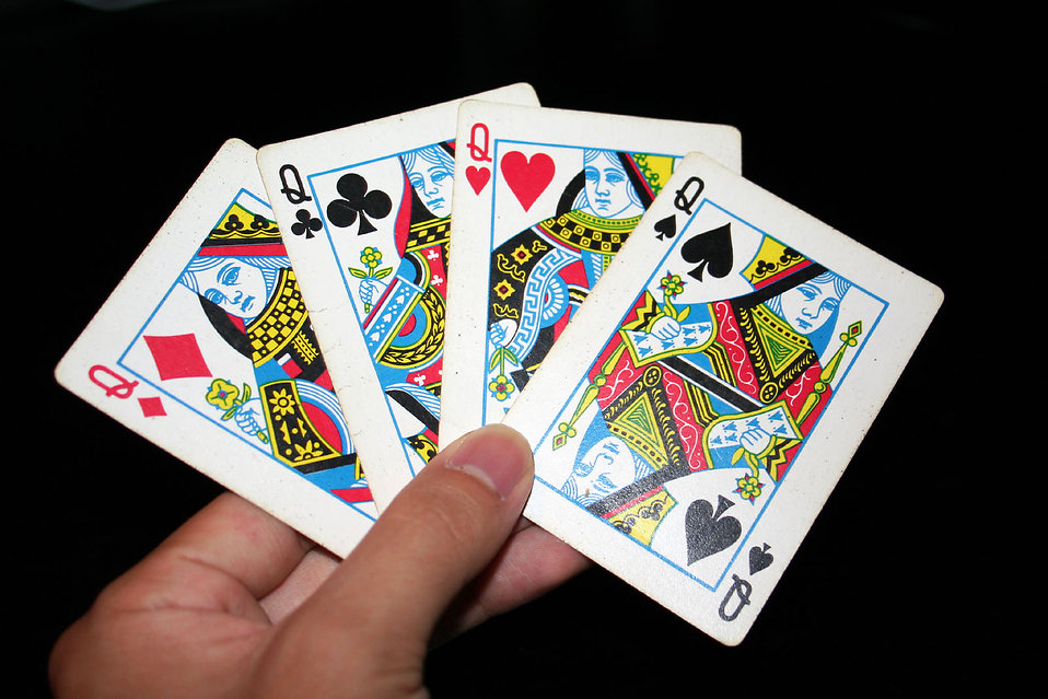 A hand holding the four Queens in a standard deck of cards : Free Stock Photo