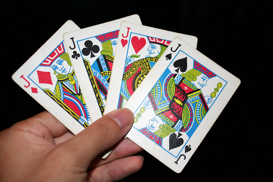 A hand holding the four Jacks in a standard deck of cards : Free Stock Photo