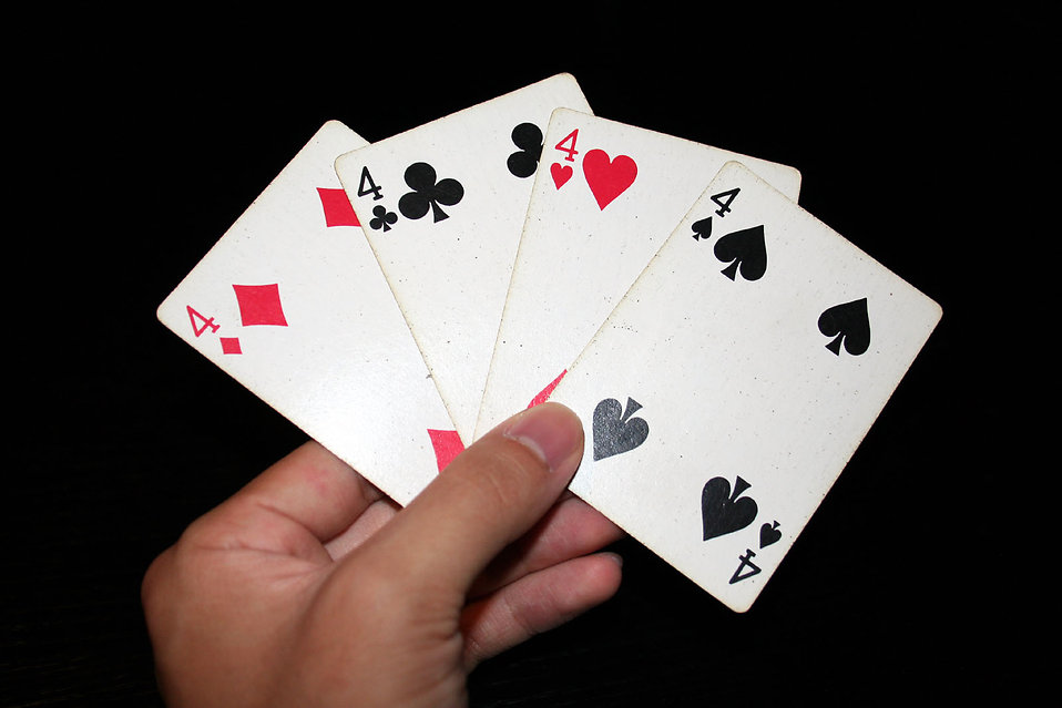 A hand holding the four fours in a standard deck of cards : Free Stock Photo
