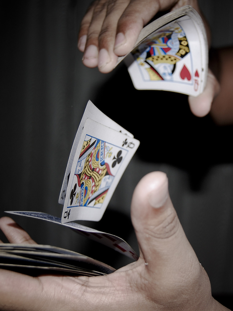 Hands shuffling a deck of cards : Free Stock Photo