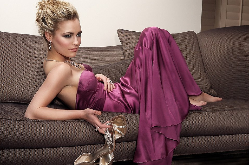 A beautiful woman in a purple dress sitting on a couch : Free Stock Photo
