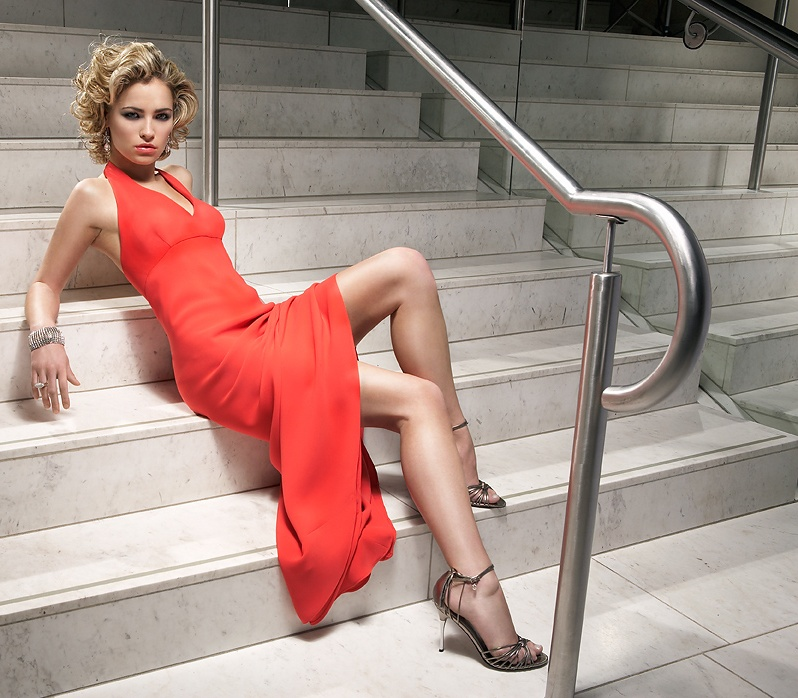 A beautiful woman in a red dress posing on stairs : Free Stock Photo