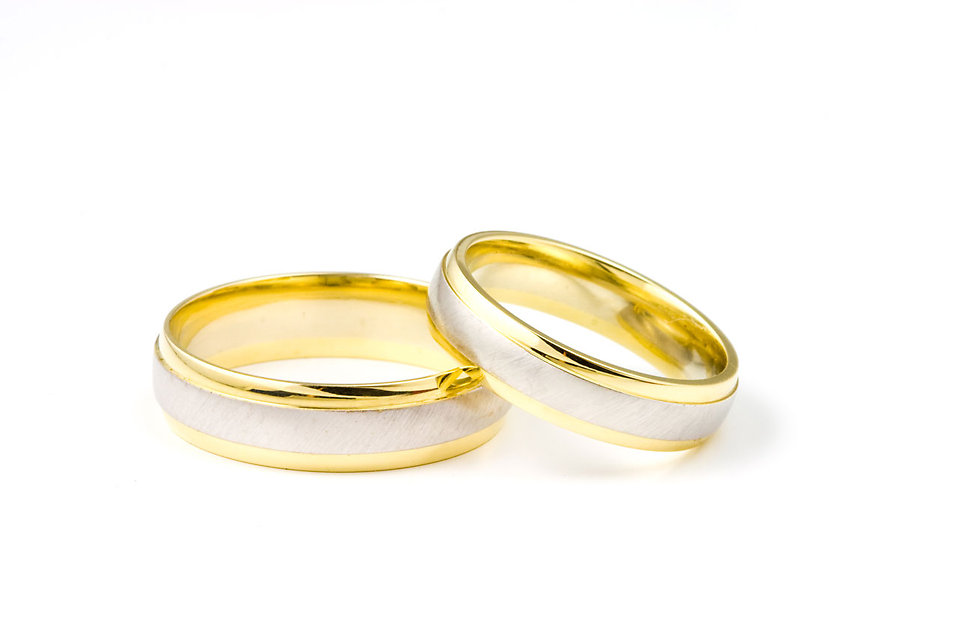 A pair of wedding rings isolated on a white background.