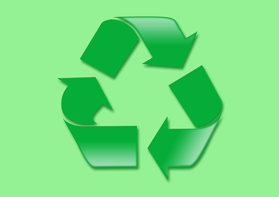 A green recycle symbol on a green background : Free Stock Photo