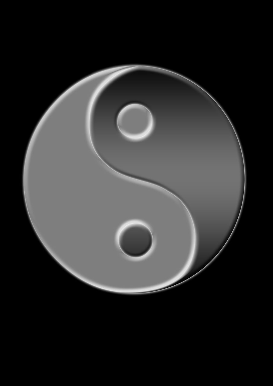 A yin yang symbol on a black background : Free Stock Photo