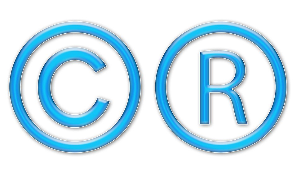 Illustration of blue copyright and registered trademark symbols : Free Stock Photo