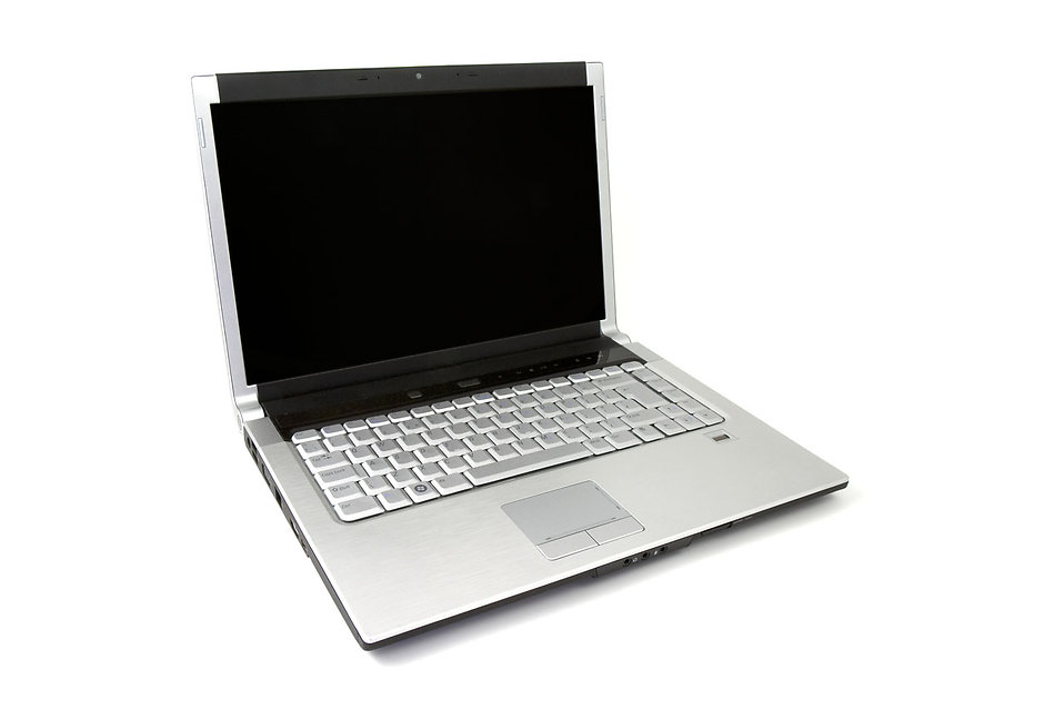 A laptop isolated on a white background : Free Stock Photo