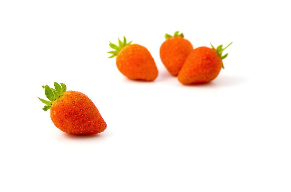 Strawberries isolated on a white background : Free Stock Photo