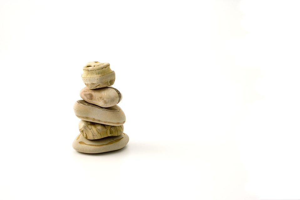 A pile of small rocks stacked on top of each other isolated on a white background : Free Stock Photo