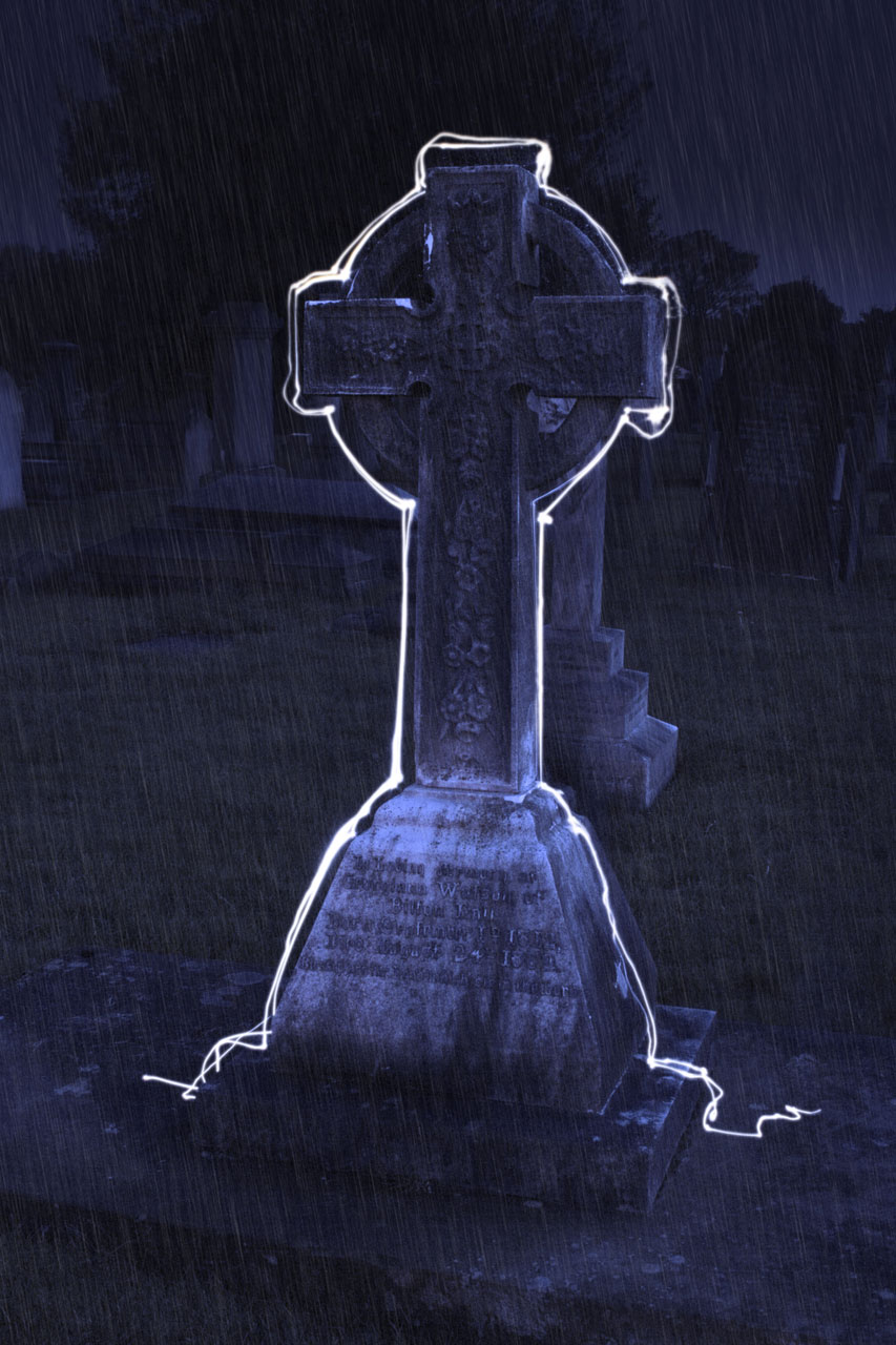 A grave stone with a white outline : Free Stock Photo